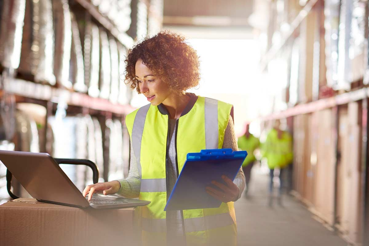 warehouse worker using computer