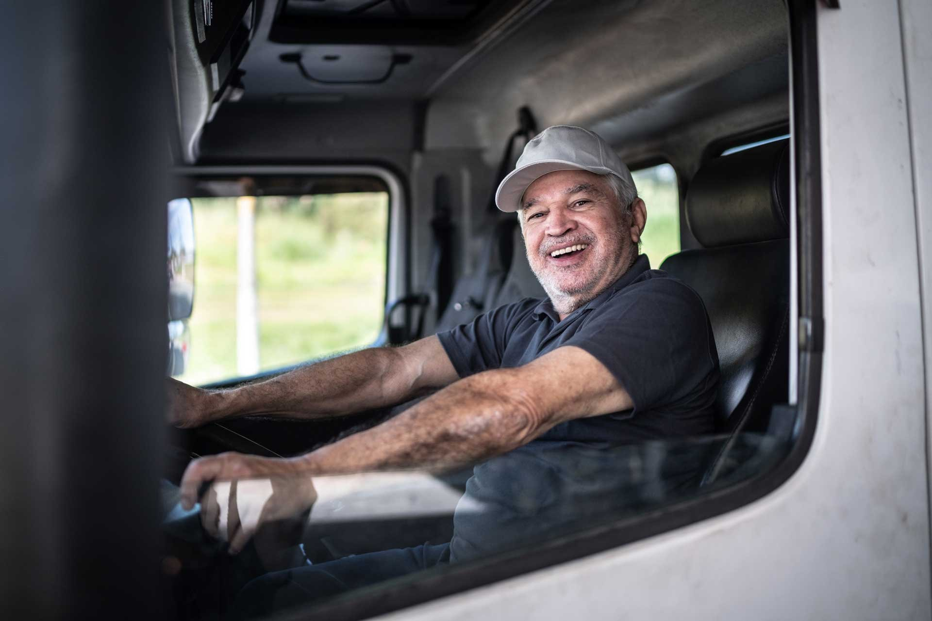 Man in truck smiling