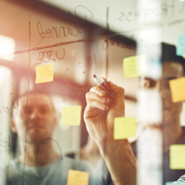 Man making a strategy with sticky notes.