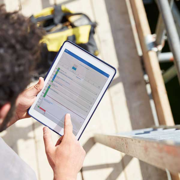 A technician uses simPRO mobile to manage his service jobs in the field.
